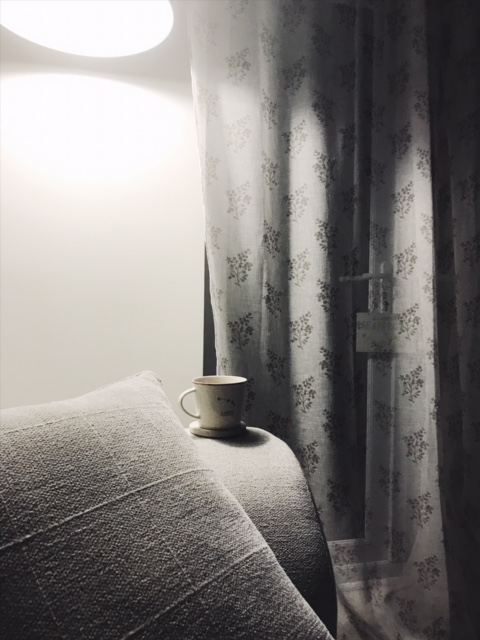 cup of tea of chair arm