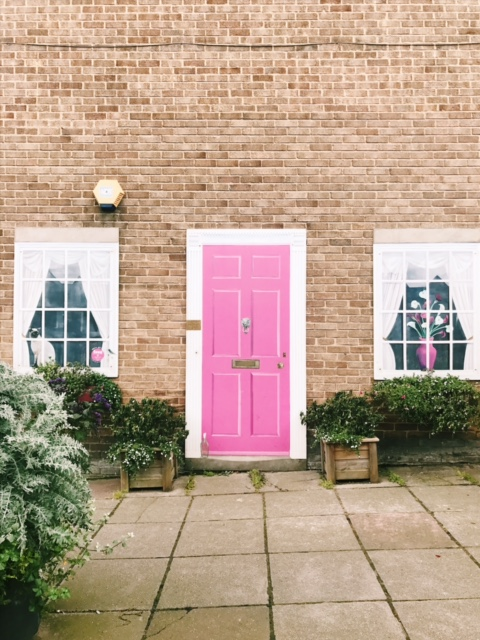 house with pink door