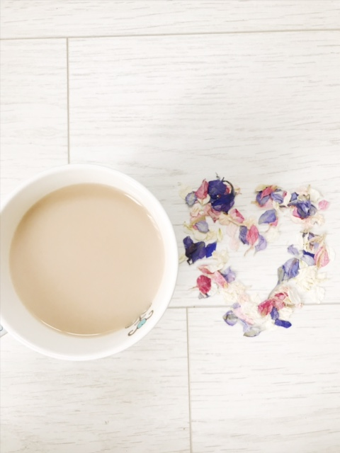 cup of tea with heart petals