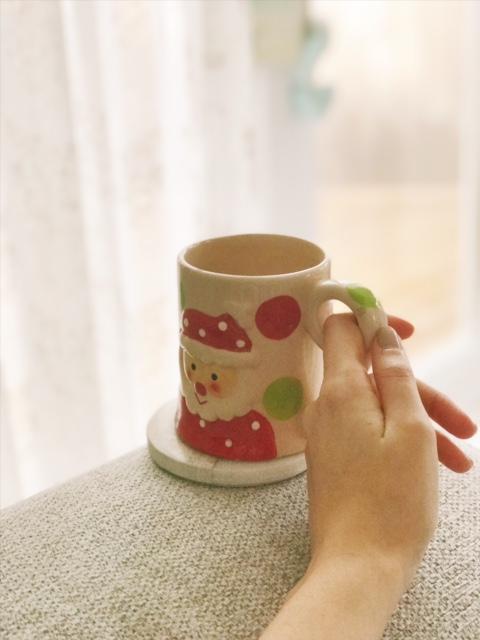 holding christmas mug