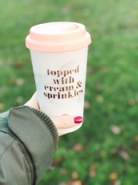 holding travel mug