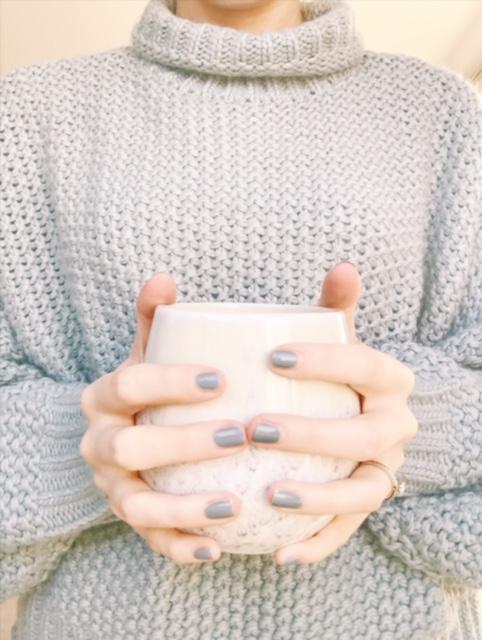holding a mug